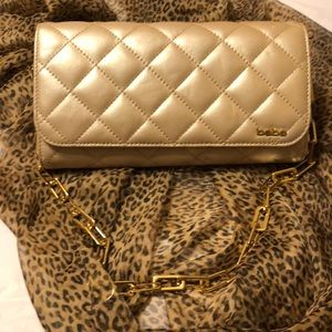 NWOT BEBE More than a Clutch/Wallet. Gold Chain.